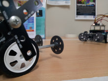 Battle robots were programmed and are ready to start a game at robotics school holiday camp