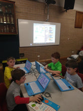 Boys are coding animation in Scratch environment at RUNSTEM coding school