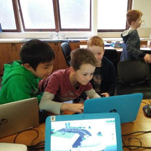 Boys are sharing their impressions at coding camp