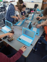 Children are building and coding robots at robotics school
