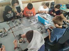 Children are building robots at robotics class