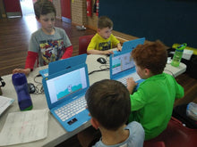 Children are coding  cool games in Scratch programming environment