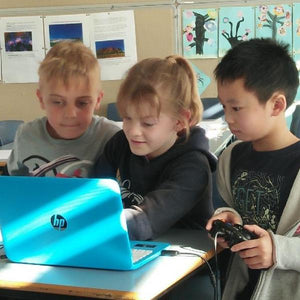 Children are playing game they have just finished coding