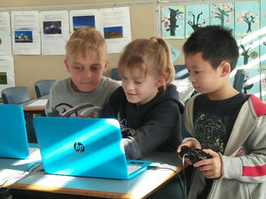 Children are playing games they have just finished coding at RUNSTEM school holidays coding camp