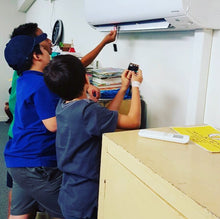 Children are testing their programmable devices as a part of school holidays program at RUNSTEM