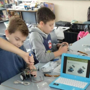 Children make build robots at robotics class