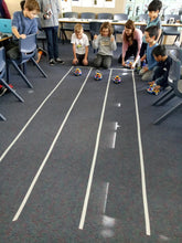 Children participate in a robotic challenge during robotics class