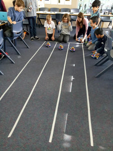Children participate in a challenge during robotics class