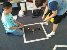 Children participate in a robotics challenge  at robotic club