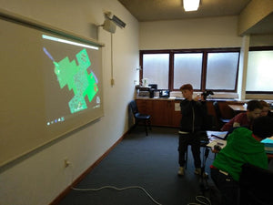 Children's code project is projected on the wall