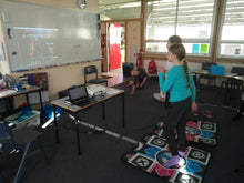 Girls have fun and dance to have some rest at school holidays coding camp