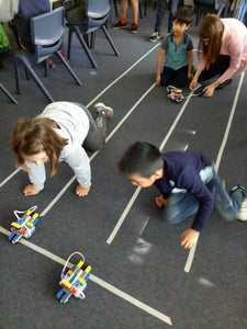 Kids code their racing bots at robotics class