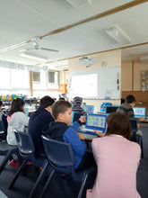 RUNSTEM teacher  teaches children how to code a game in Scratch visual programming environment