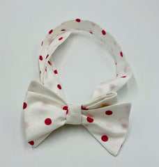 Self tie bow tie in a white cotton with pink polka dots.  Purely whimsical and charming.  Adjustable neck strap for perfect fit.