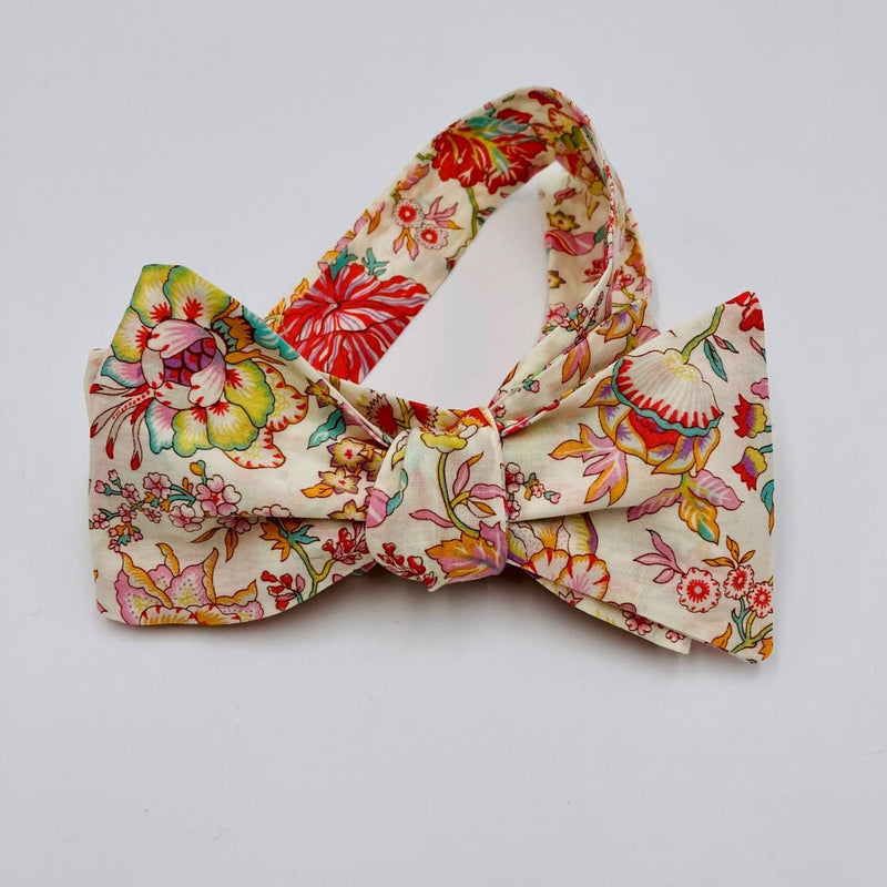 Self-tie bow tie with adjustable neck clasp for perfect fit.  Cut from Liberty of London Tana Lawn fabric.  Pale background with floral print in muted pinks