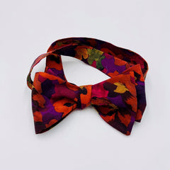 Stunning self tie bow tie with adjustable neck clasp for perfect fit.  Cut from Liberty London Tana Lawn pima cotton.  Jewel tones of red, purple, burnt orange.  Pansy floral pattern.