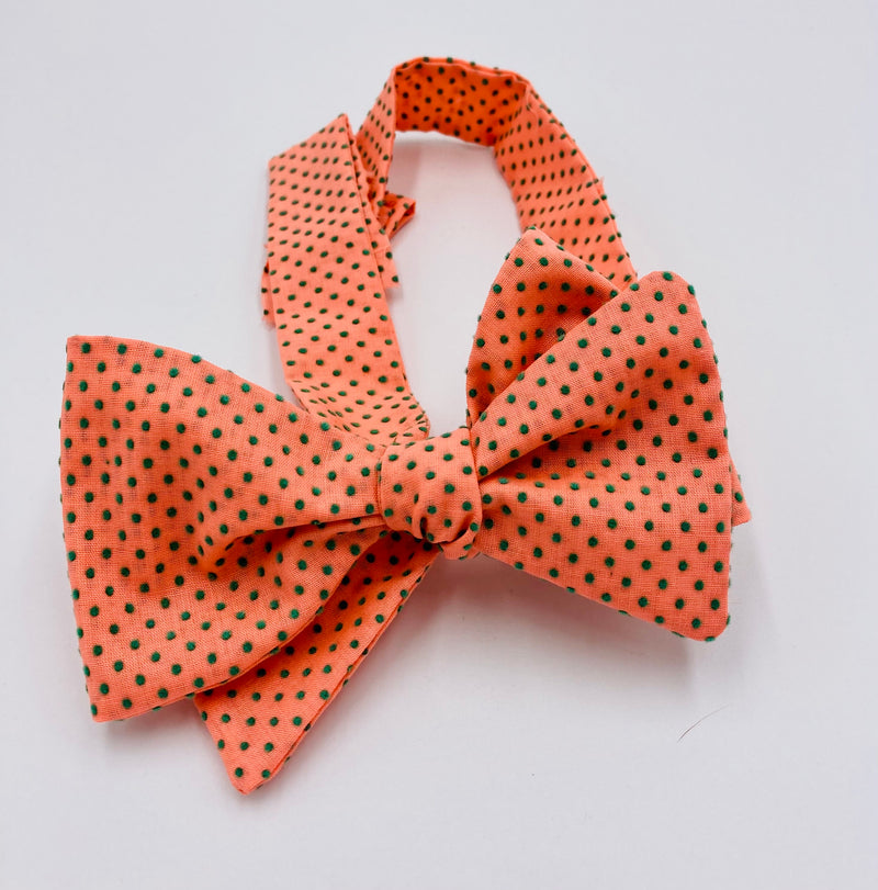 Self-tie bow tie crafted from vintage swiss dot in a peach with muted green dots.  Amazing look and feel for anyone that wants to stand out at your next fromal event.