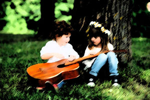 Rafa Selase relaxing music for kids image of a little boy with guitar and girl no more than 4 years old sitting on the grass with their backs against a tree
