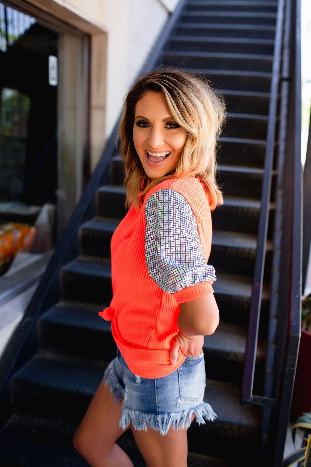 She's Gonna Run Sequin Sleeve Top - Neon Coral - West Avenue