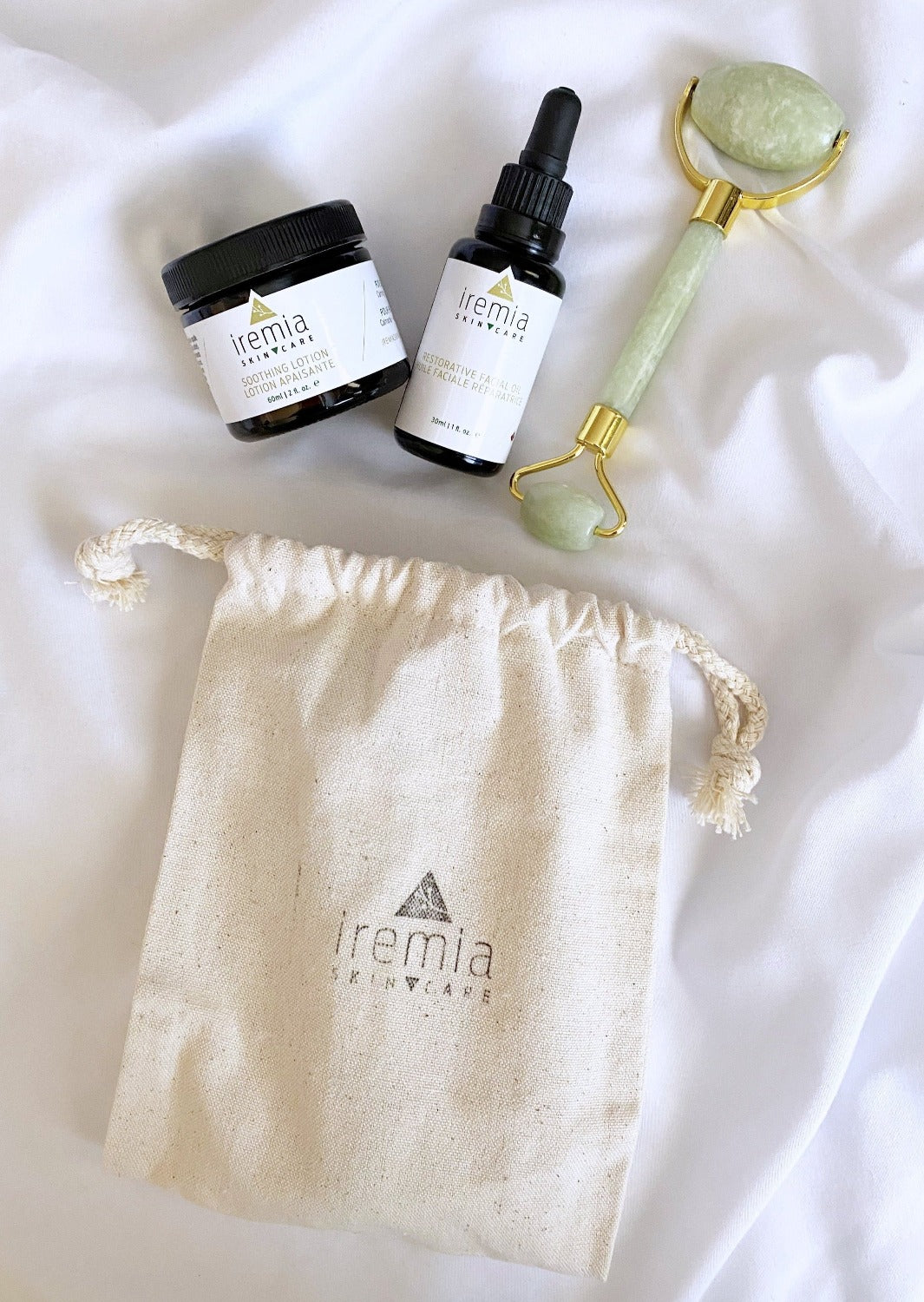 Calming Radiance Set from Iremia Skincare. Includes the Soothing Lotion, Restorative Facial Oil and Nara Jade Roller. Best natural ritual for sensitive skin. Simple minimalistic routine for sensitive skin. Made in Canada.