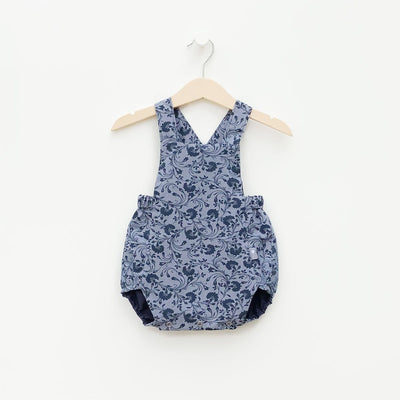 The conserve collection is a collection of bubble rompers made from rescued shirts. Reversible Navy Blue floral and Solid. Boys and Girls Classic Style
