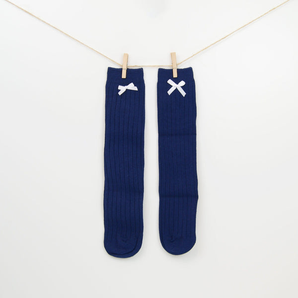 Knee-High admiral blue cable knit socks with cute white bow.