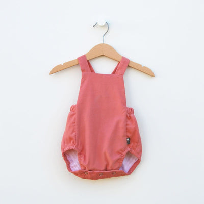 Cute European style classic baby Classic baby bubble romper in soft pink corduroy.