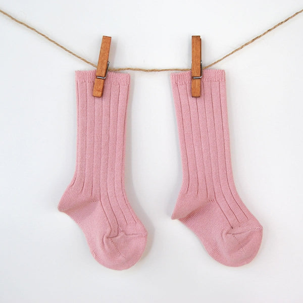 Tall cable knit patterned cuff socks in old pink.