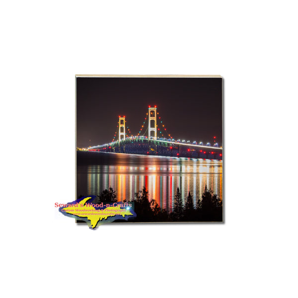 A nightly reflection of the Mackinac Bridge on a vivid tile coaster