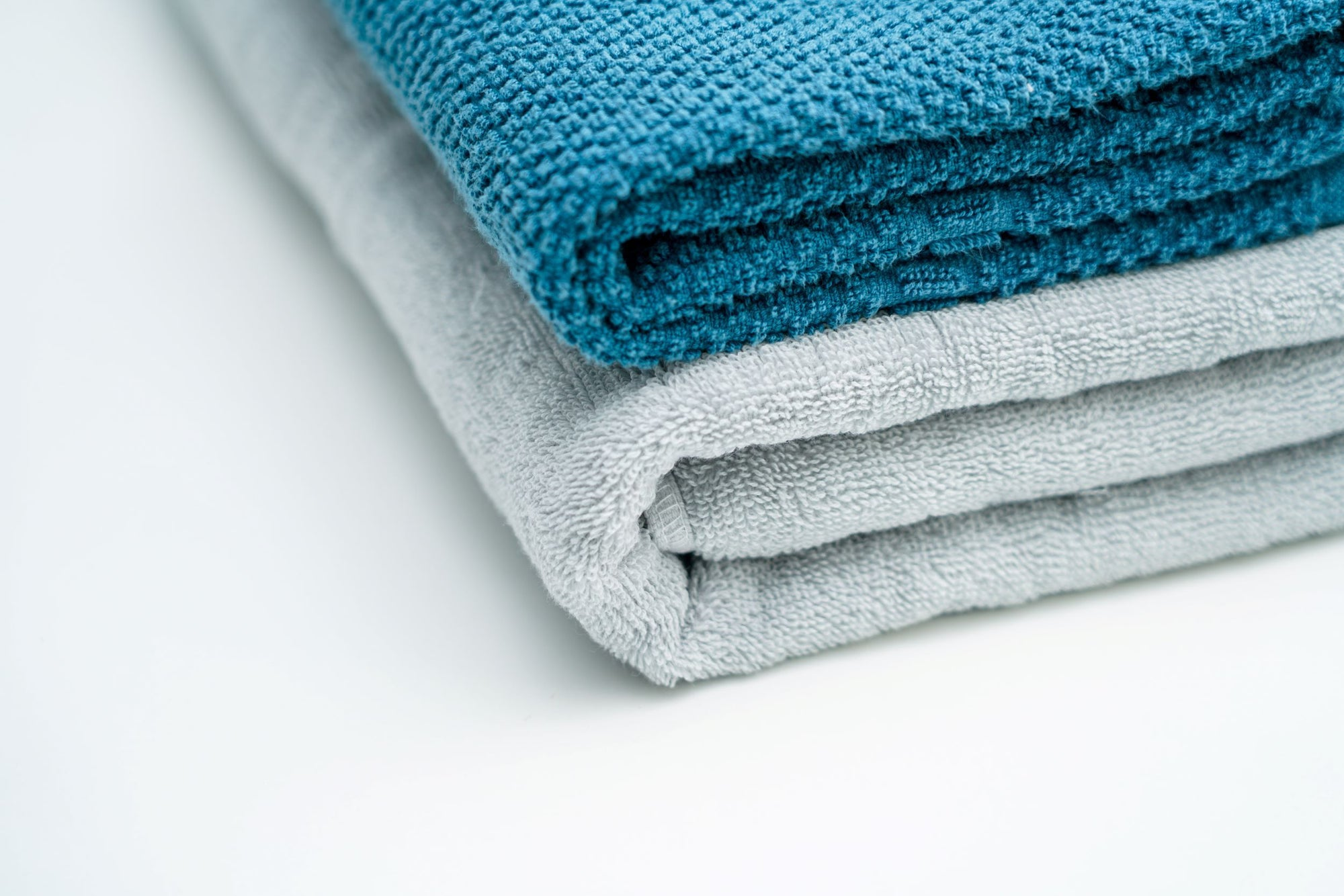 Folded Towels turquoise and grey color
