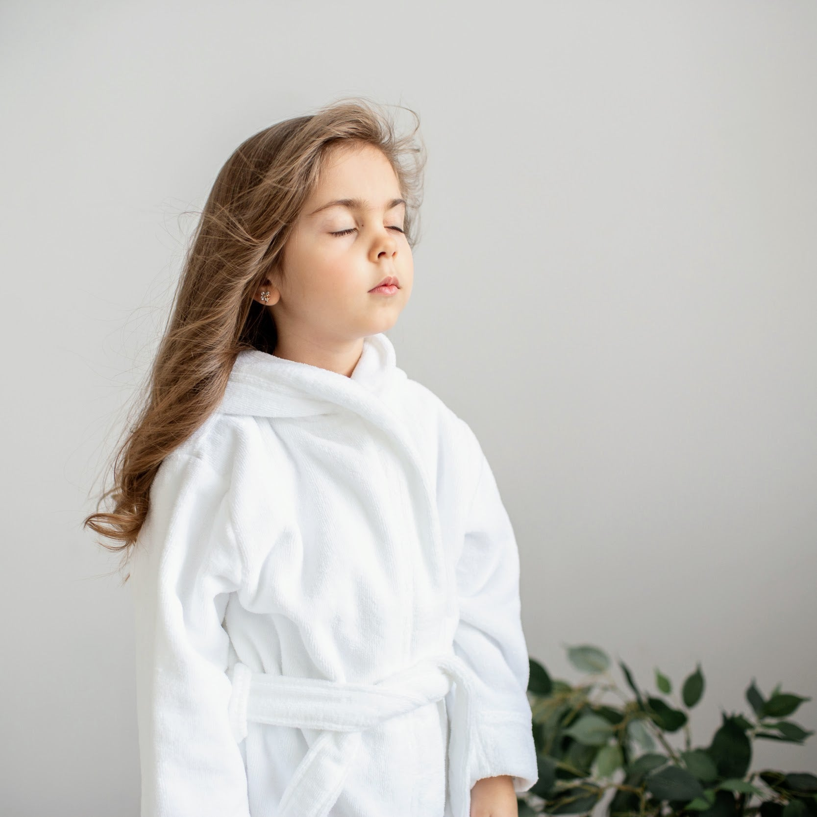 Girl standing with closed eyes in white bathrobe White+Kimono