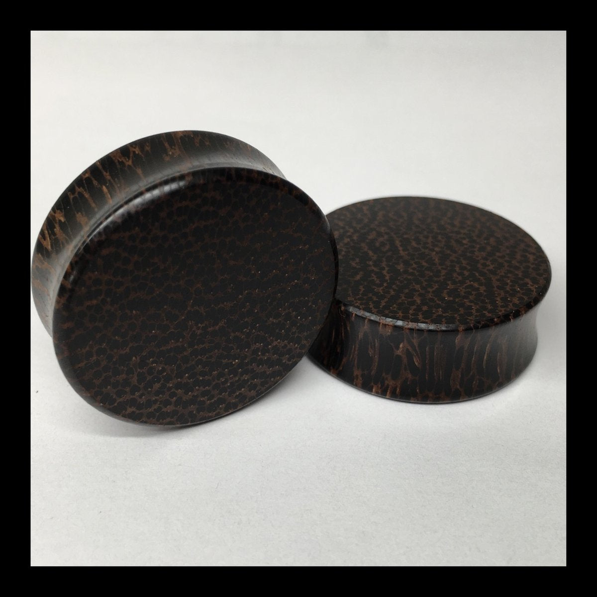 Black Palm Solid Round Plugs