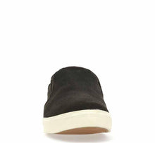 Slipper shoes for men in dark grey smoke color with plush tan lining and white bottom trim.