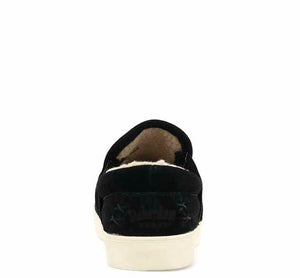 Womens slipper sneakers with thick white trim, wheat suede upper, and faux-fur lining.