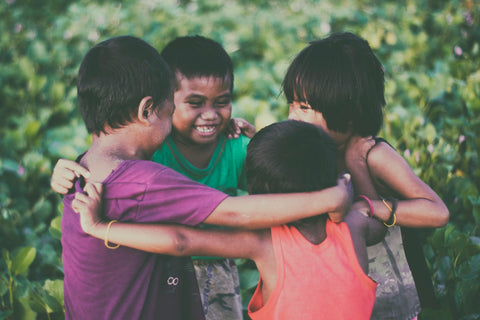 Children Embracing - Charitable Giving