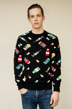 Male model wearing a knit sweater,  100% cotton. All over pills and pills box and syringe spleen lookbook FW18 fashion streetwear.