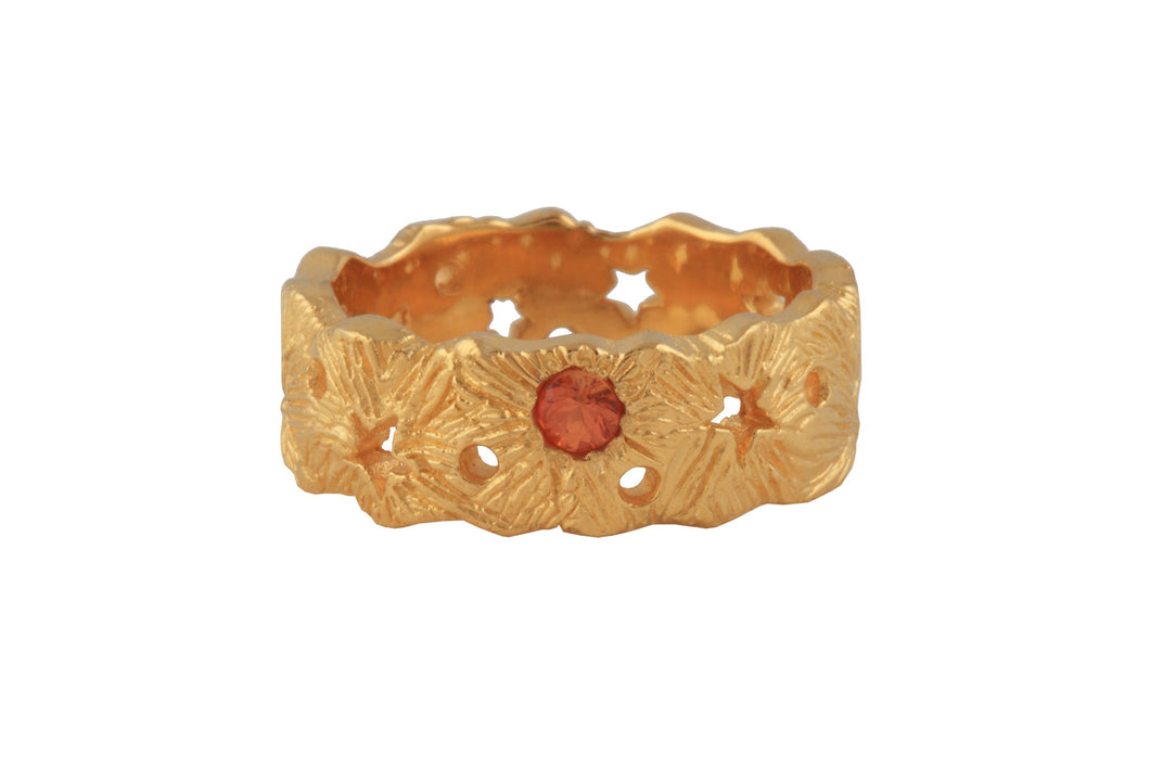 Cosmic ring with yellow or orange 3mm sapphire. Gold plated.