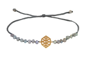 "Beaded semprecious stone bracelet with ""New Level of concsiousness"" amulet. Gold plated."