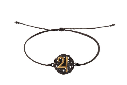 String bracelet with Jupiter medalion amulet. Gold plated and oxide.