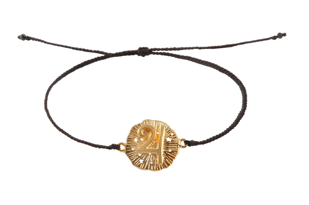 String bracelet with Jupiter medalion amulet. Gold plated.