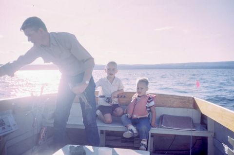 Father and sons on boat