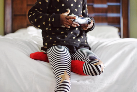 Little girl playing video game