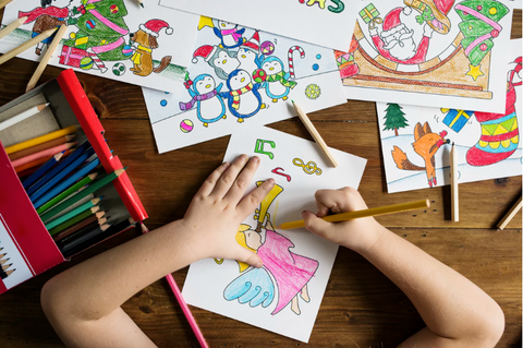 Child colouring christmas pictures