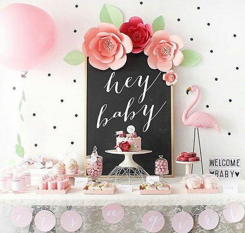 Pink baby shower table and decor