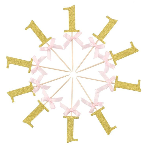 10 Sparkly gold, number one, cake toppers with pink bow for sale via www.Cleybaby.com