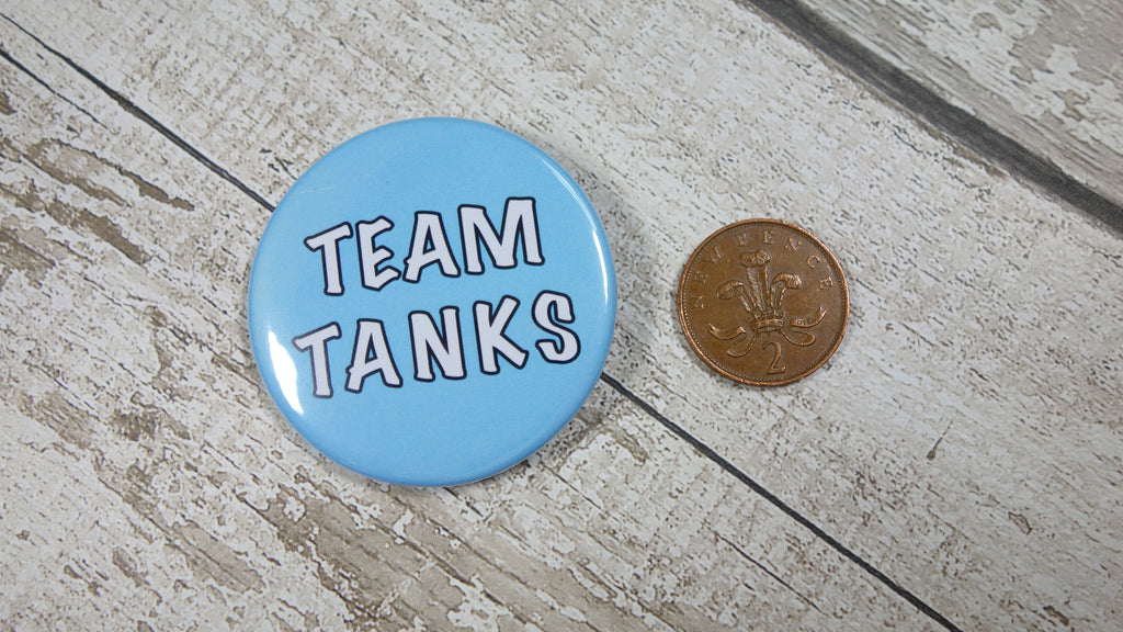Blue 58mm Team Tank Gender Reveal badges for sale via www.Cleybaby.com