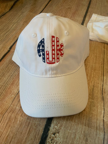 White unstructured, adjustable hat with American Flag monogram