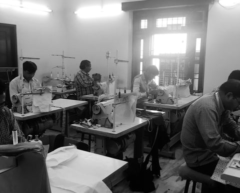 artisans making baby swaddles from organic cotton