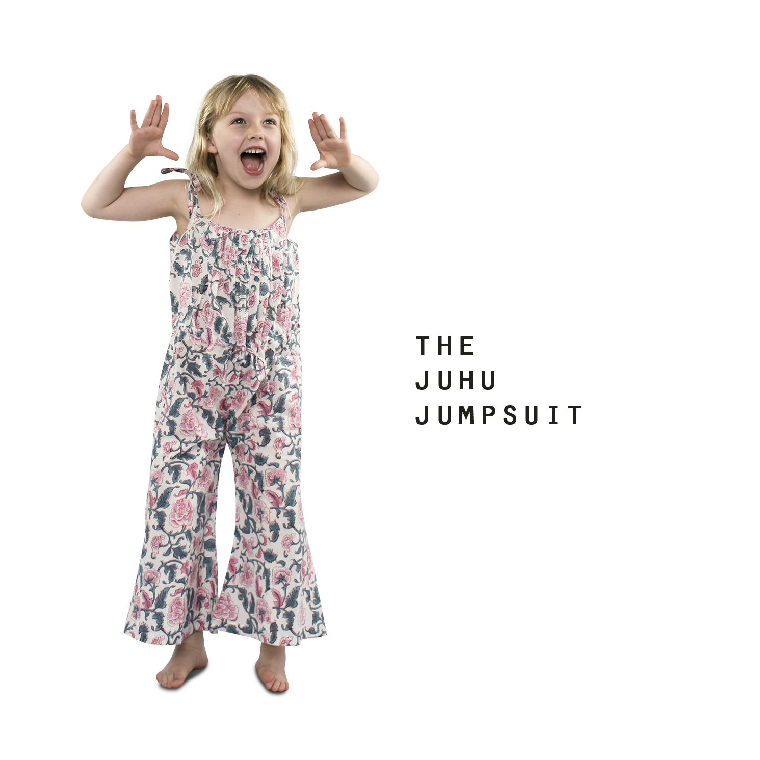 little girl wearing jump suit made from organic cotton