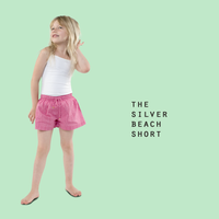 little girl wearing beach shorts made from organic cotton